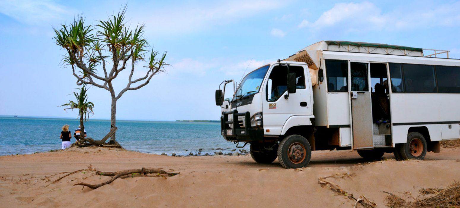 tour truck on a beach.