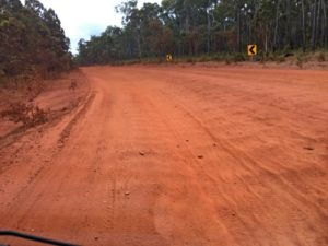 Red dirt road with corrugations