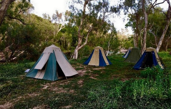Camp tents next to river