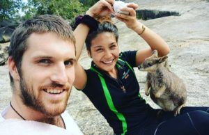 Man and lady with rock wallaby