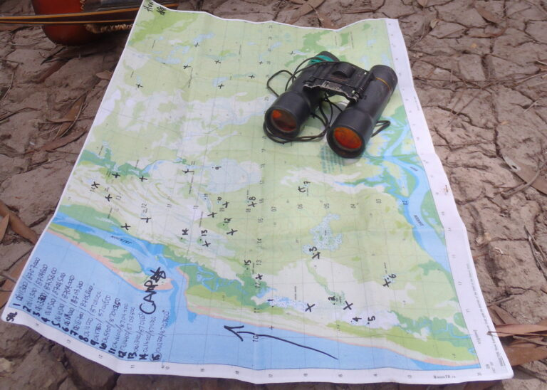 Binoculars and a map