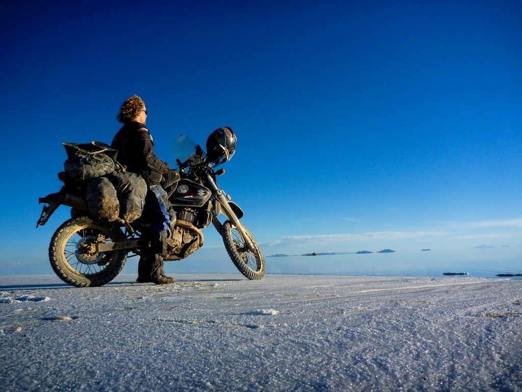 man on motorbike overlooking the Salar de Uyuni