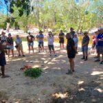 Aboriginal man and people around fire