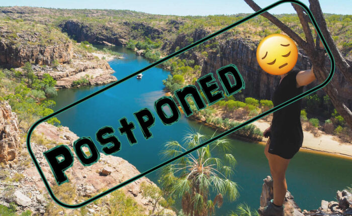 lady standing above nitmiluk gorge with postponed stamp