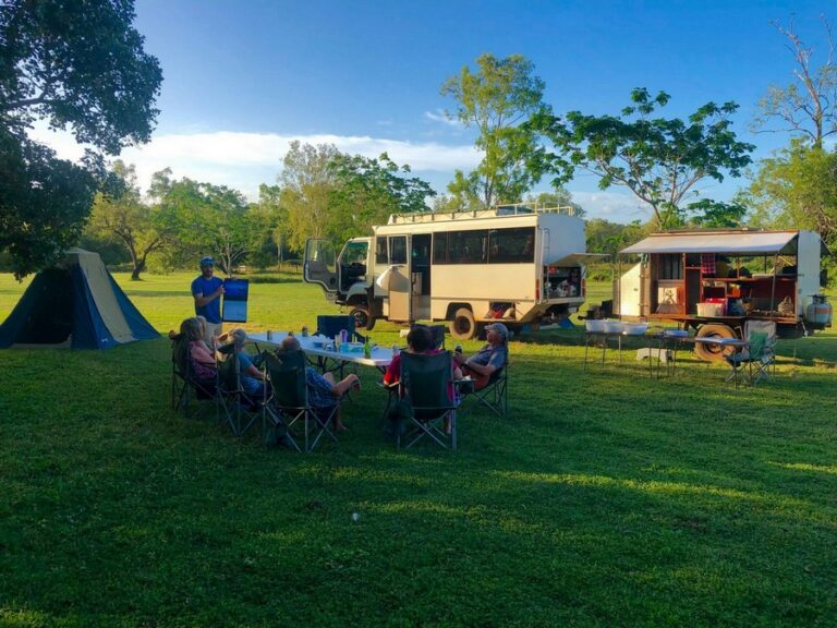 Tour Truck at Camp with people relaxing