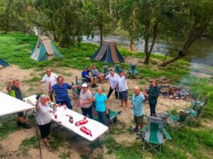 People bush camping by river