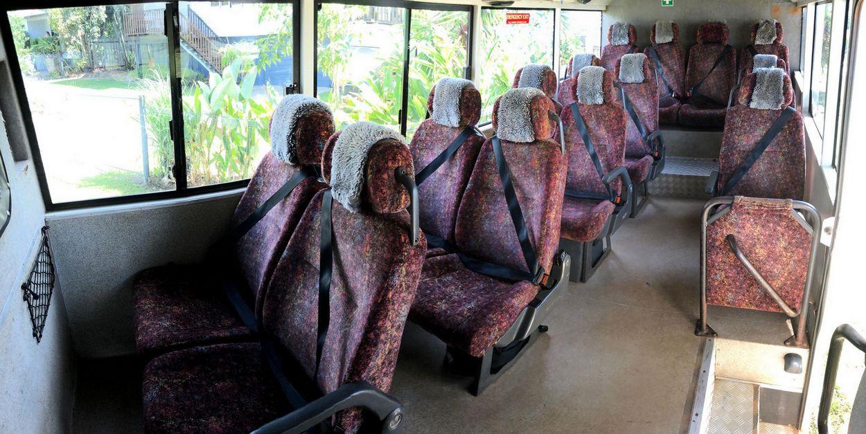 seats inside an isuzu tour truck