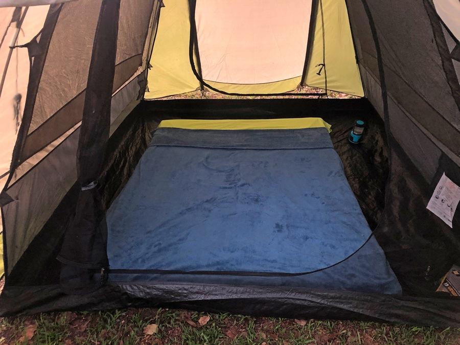 a mattress set up inside a tent
