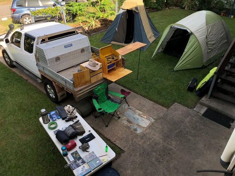 camp gear laid out in yard